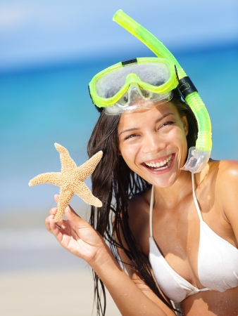 scuba goggles: Summer beach vacation holidays woman wearing snorkeling mask showing star happy joyful and laughing