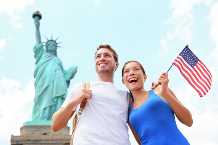 liberty: Tourist travel couple at Statue of Liberty, New York City, USA