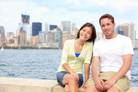 Young couple dating in New York  Portrait of multi-ethnic couple with Manhattan and New York City Skyline photo