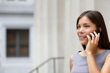 wallstreet: Woman businesswoman lawyer talking on smart-phone outdoors in front of courthouse Stock Photo