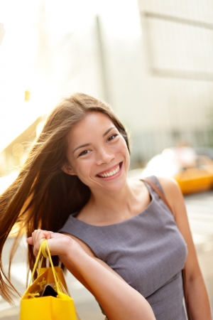 Shopper smiling happy outdoor in streets of New York photo