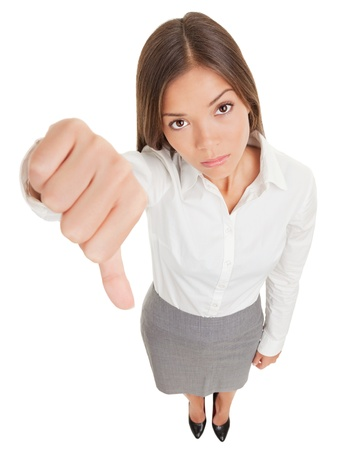 demotivated: Sad young business woman making a thumbs down sign looking with disapproval background in high angle view