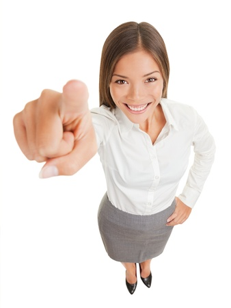 pinpoint: Positive business woman pointing her finger at camera isolated on white on white background