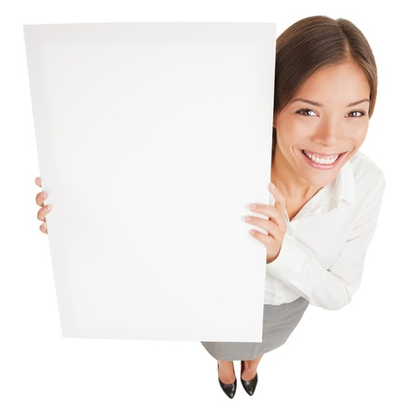 saleswomen: Woman showing a white board sign poster  High angle shot of attractive smiling woman with a blank white board isolated on white background  Mixed race Asian Caucasian business woman smiling happy