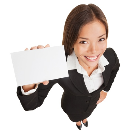 businesswoman card: Business woman showing blank card sign. Businesswoman holding empty card with copy space smiling happy standing isolated on white background in full body length. Mixed race Asian Chinese  Caucasian.