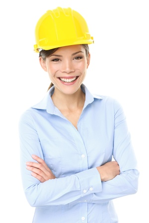 blue helmet: Engineer, entrepreneur or architect business woman. Portrait of smiling happy, proud and confident young multiracial Asian Chinese  Caucasian female professional wearing yellow hard hat. Stock Photo