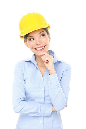 Engineer, entrepreneur or architect woman thinking looking up and showing copy space. Young female mixed race Caucasian / Asian Chinese professional. Stock Photo - 17718676