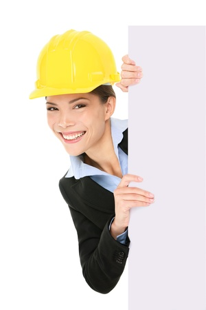 Engineer entrepreneur architect business woman showing blank white sign for copy space Stock Photo - 17718681