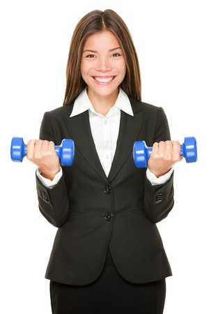 Business woman in suit lifting dumbbell weights photo