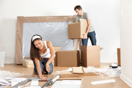 cardboard house: Couple moving in new home house Stock Photo