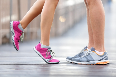 Love sport concept - running couple kissing  Closeup of running shoes and girl standing on toes to kiss boyfriend during jogging workout training outdoors on brooklyn bridge, New York City  Stock Photo - 18207180