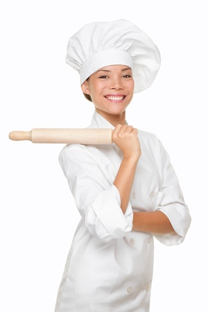 Baker woman smiling proud with baking rolling pin  Chef or baker in uniform hat hat smiling happy portrait isolated on white background  Multiracial Caucasian Asian woman baker  photo