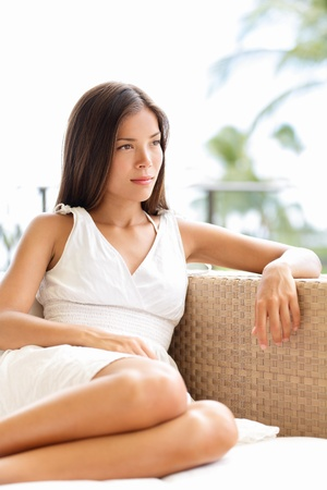 Confident serious sophisticated woman thinking and looking outdoors in luxury setting Stock Photo - 18622918