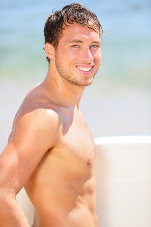 bodyboarding: Surfer beach man  holding surfboard under the sun on sunny summer day