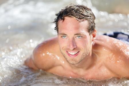 bodyboard: Beach man having fun in water smiling happy surfing on bodyboard.