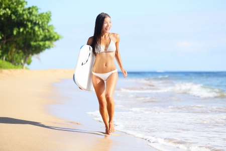 Beach woman fun with body surfboard photo