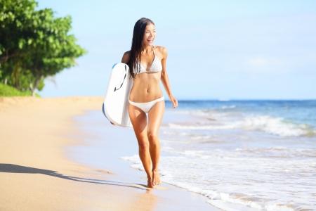 asian bikini: Beach woman fun with body surfboard