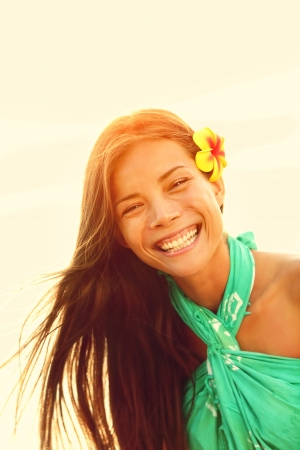 Sunshine smiling summer girl laughing happy looking at camera enjoying the summer sun sunset during holidays vacation. Young woman on Hawaiian beach. Pretty multicultural Asian Caucasian female model Stock Photo - 18730938