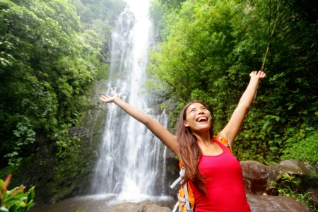 hawaiian girl: Hawaii woman tourist excited by waterfall during travel