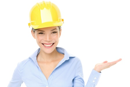 woman hard working: engineer or architect woman showing pointing at copy space Stock Photo
