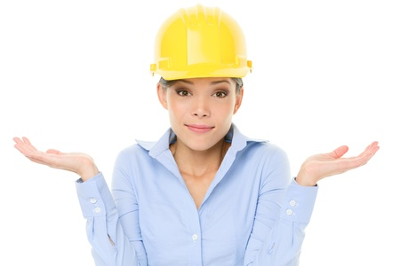 shoulder problem: Engineer, entrepreneur or architect woman shrugging lifting shoulders in doubt about decision