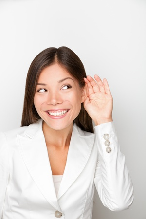 hears: Businesswoman listen to something smiling happy