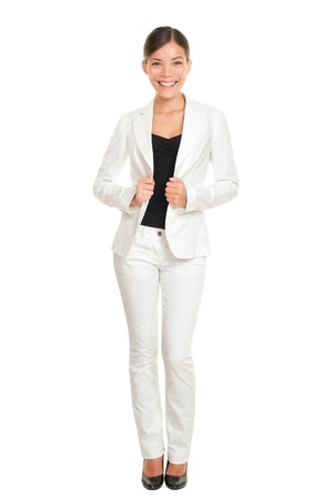 Business woman young professional standing in white suit smiling confident photo