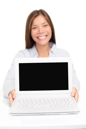 Laptop computer - woman showing screen smiling happy Stock Photo - 18906179