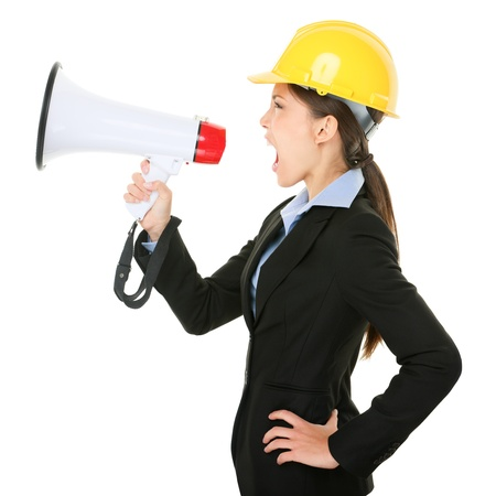 Megaphone screaming engineer contractor business woman with hard hat yelling angry photo