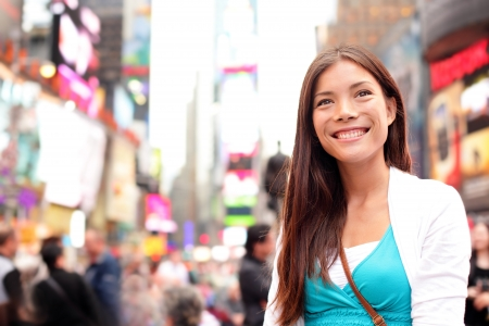 new york city times square: New York City woman as Times Square tourist or young casual woman visiting