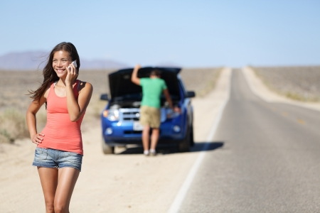 Car breakdown - woman phone calling auto service Фото со стока