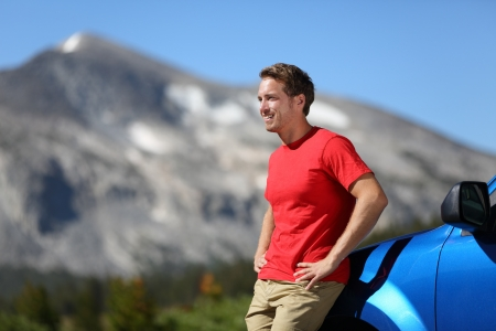 adventure holiday: Portrait of happy man looking at view and mountains during summer road trip travel
