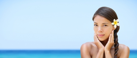 Spa woman on travel beach resort with perfect skin for beauty skin care  Beautiful mixed race Caucasian Asian ethnic girl looking serene a camera during holidays vacation  Panoramic banner on beach  photo