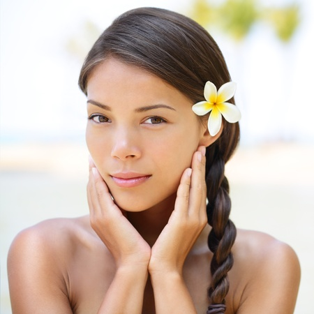 hawaiian: Spa resort beauty portrait of woman looking at camera serene outside. Beautiful skin care concept with multiethnic model girl with perfect skin. Stock Photo