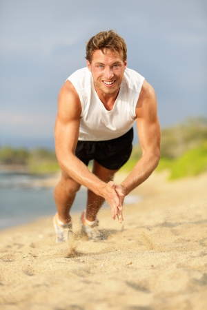Fit male trainer and fitness model exercising intensely outside showing strength and power. photo