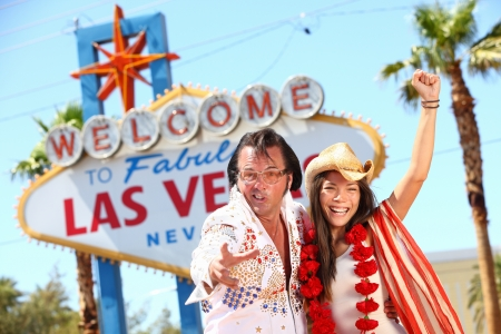 lookalike: Funny happy joyful image with Elvis and smiling happy beautiful girl wearing cowboy hat on the Strip
