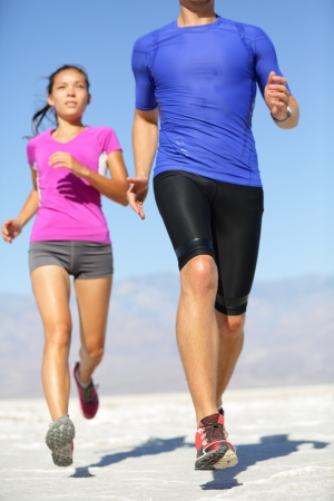 Couple runners training outside photo