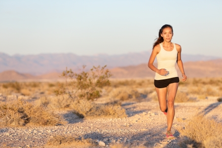 Female jogger training outside on path outdoors at summer sunset Stock Photo - 19500178