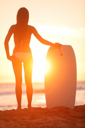 Surfer beach woman with water sport body board photo