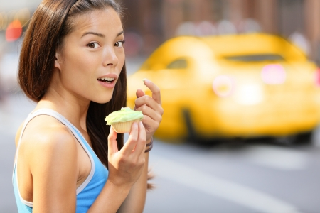 guilt: Funny image of fitness girl surprise shocked eating unhealthy food Stock Photo