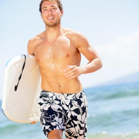 bodyboarding: Handsome man surfer fun on summer beach