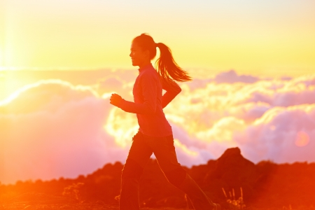 beautiful sunshine: Running - woman runner jogging at sunset  Fitness spot girl training in sunny sunshine with flare and sun glow  Aspirations workout image with asian jogger