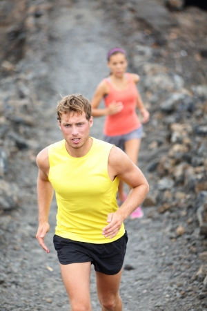 crosscountry: Runner man running on trail in cross-country run outdoors training Stock Photo