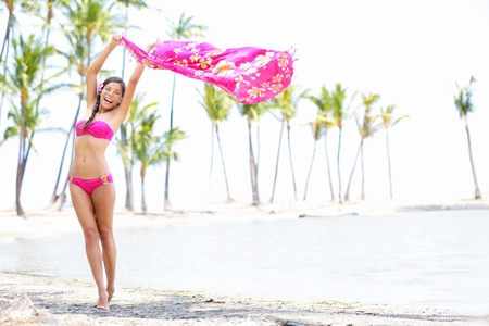 bikini woman on paradise beach waving scarf sarong