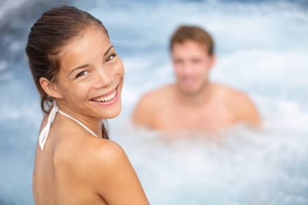 Young couple in hot tub in Spa resort
