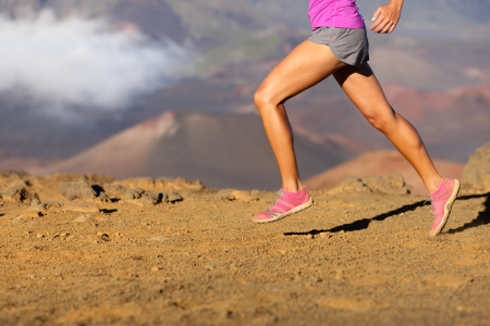 running shoes: Running sport fitness woman. Closeup of female legs and shoes in action. Girl athlete fitness runner sprinting fast outside in barefoot running shoes. Trail running concept.