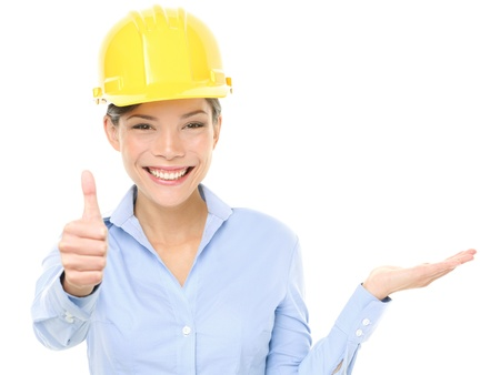 hard look: Engineer or architect woman. Portrait of beautiful female architect gesturing thumbs up while displaying product isolated over white background