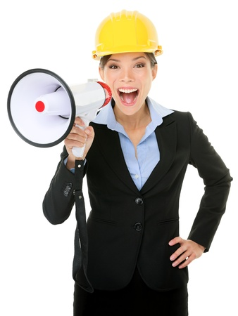 Portrait of young businesswoman shouting into megaphone isolated on white background photo