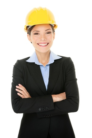 female architect: Portrait of confident young female architect standing arms crossed isolated over white background