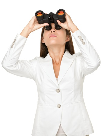 Young businesswoman looking through binoculars isolated on white background Stock Photo - 20733082